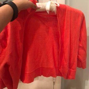 orange/pink cropped cardigan
